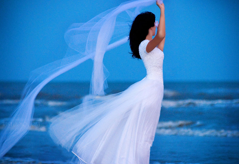 galveston blue sky bride flying veil bridal portrait
