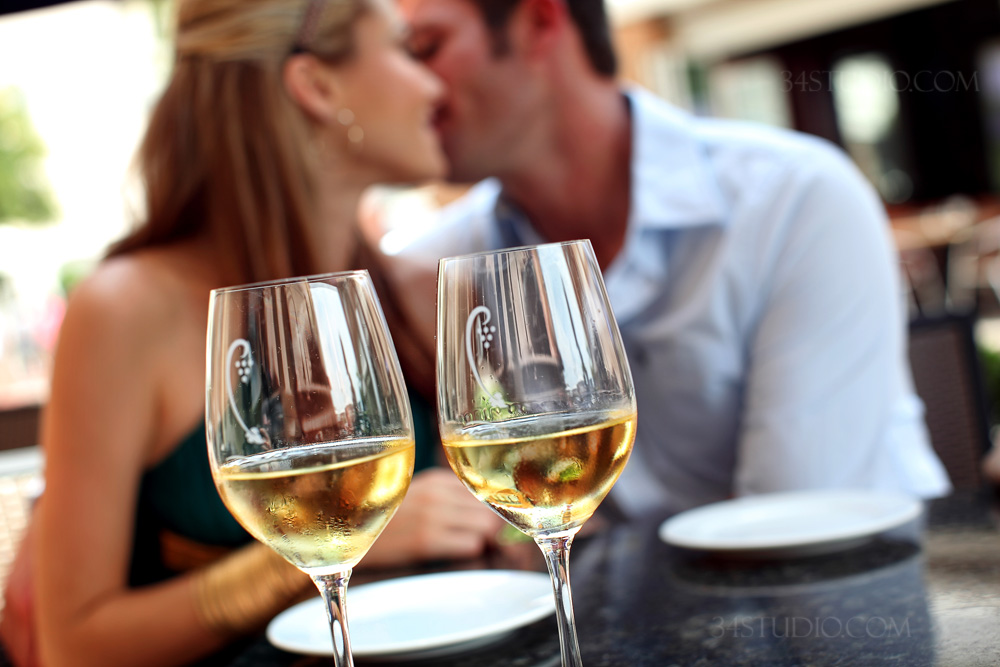 couple drinking wine in west village dallas