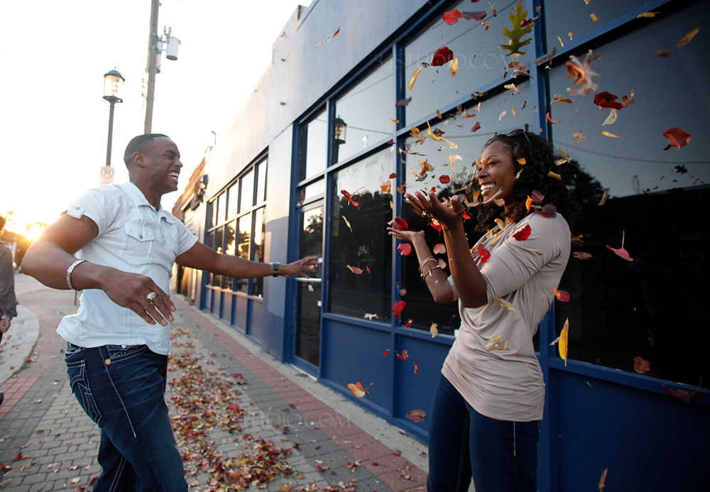 couple playing with leaves in deep ellum downtown dallas
