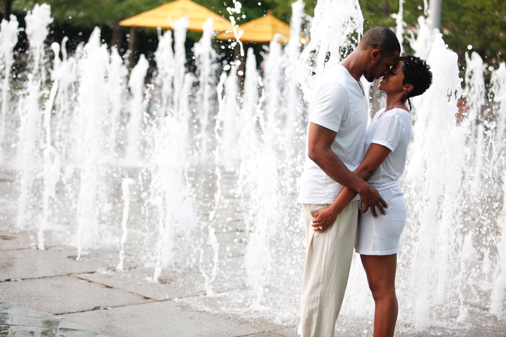 dallas downtown fountain water splash engagement